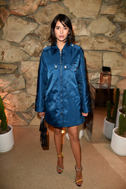 Nina Dobrev was tough-glam in a blue policeman coat by Calvin Klein at the launch of Proenza Schouler's Arizona fragrance.