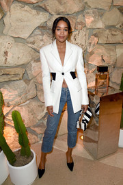 Laura Harrier coordinated her blazer with a black-and-white striped clutch.