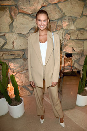 Romee Strijd sported an oversized khaki pantsuit at the launch of Proenza Schouler's Arizona fragrance.