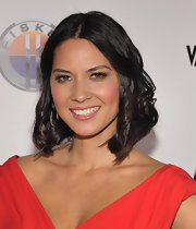 Olivia Munn add a few curls to her sleek bob for the 'Vanity Fair' and Fisker Automotive Golden Globes Event.