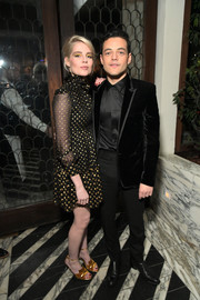 Lucy Boynton coordinated her dress with a pair of gold velvet sandals.