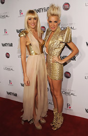 Mim Nervo made sure she stood out from the crowd in this fashion-forward metallic gold gown.
