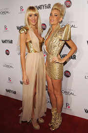 Liv Nervo was glammed up in a gold and nude gown with metal shoulder pads on the red carpet.
