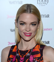 The bright pink of Jaime King's lips brought out the pink in her print cocktail dress.