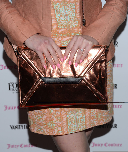 Zoe Lister Jones' proved you can never be too matchy-matchy with an oversized clutch, print dress, and jacket.
