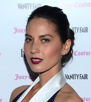 Olivia Munn's berry lipstick popped against her her olive skin and navy blue dress.