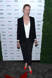 Gretchen Mol stuck to a black blazer so as to let her polka dot pants and red shoes make a statement at the 2013 Vanities Calendar celebration.