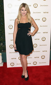 Renee Olstead wore this black cutout dress to the Vanity Fair anniversary party.