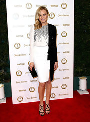 Malin Akerman complemented her asymmetric two-tone dress with a beaded black clutch and matching strappy sandals.