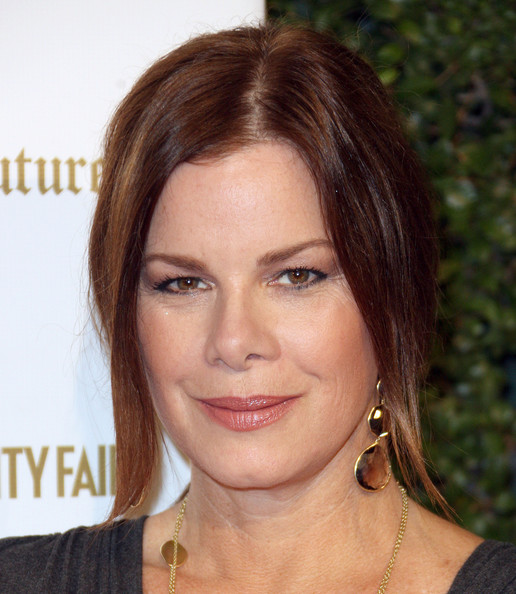 Marcia Gay Harden wore a pair of dangling citrine earrings at the Vanity Fair and Juicy Couture's anniversary celebration.