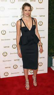 Teresa Palmer looked provocative in this black cutout dress with a statement peplum.