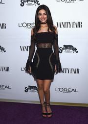 Victoria Justice was goth-chic in a black lace-panel off-the-shoulder dress by Vatanika at the Toast to Young Hollywood event.