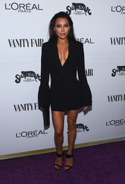Naya Rivera flaunted her cleavage and legs in a plunging black tux dress with bell sleeves at the Toast to Young Hollywood event.