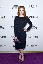 Annalise Basso polished off her look with a paneled hard-case clutch by Emm Kuo.