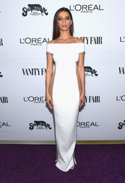 Angela Sarafyan sent pulses racing when she wore this white Celia Kritharioti off-the-shoulder gown with sheer side panels at the Toast to Young Hollywood event.
