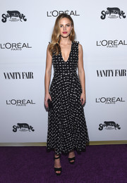 Halston Sage looked fetching in an appliqued black-and-white fit-and-flare dress at the Toast to Young Hollywood event.