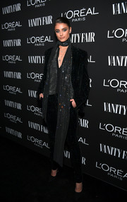 Taylor Hill rocked a sparkling pantsuit and scarf combo at the Vanity Fair New Hollywood celebration.