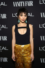 Rowan Blanchard looked sassy in a black tank top and yellow paillette pants by Prada at the Vanity Fair New Hollywood celebration.