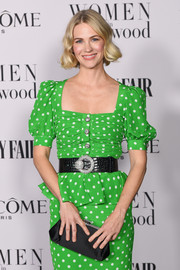 January Jones styled her green dress with a broad black croc-embossed belt by Alessandra Rich for the Vanity Fair Women in Hollywood celebration.