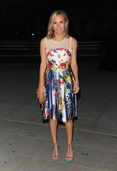 Tory Burch complemented the yellow in her floral print Erdem dress with a gold Full Bead square clutch.