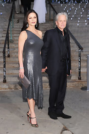Catherine Zeta Jones stepped out in glitzy gold sandals with glossy black detailing.
