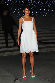 Helena Christensen showed off her summery tan in this little white perforated dress at the 'Vanity Fair' party.