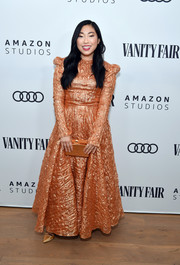 Awkwafina gleamed in a long-sleeve copper gown by Christian Siriano at the Vanity Fair x Amazon Studios 2020 awards season celebration.