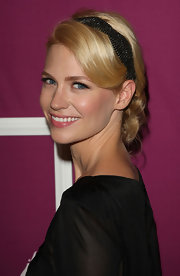 January wears a black sequined headband to hold together this elegant updo.