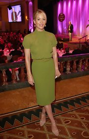 Christina Applegate complemented her vibrant green dress with nude lattice ankle strap sandals.