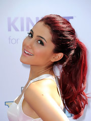 Ariana Grande highlighted her fiery locks by slicking her hair back in a sleek ponytail.