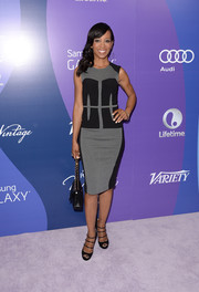 Shaun Robinson chose a modern gray and black sheath for the Variety Power of Women event.