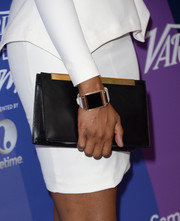 Jennifer Hudson completed her elegant ensemble with a black leather clutch featuring gold hardware when she attended the Variety Power of Women event.