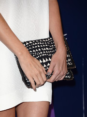 Charlize Theron paired a black-and-white heart-print clutch with her simple dress for a chicer finish at the Variety Power of Women event.