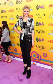Caroline topped off her black and white ensemble with black suede ankle boots.