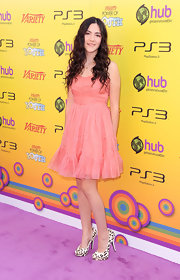 Isabelle Fuhrman looked perfectly youthful at the Power of Youth event in a pink cocktail dress with a ruffle hem.