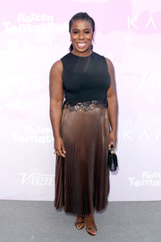Uzo Aduba attended Variety's brunch for awards nominees wearing an ankle-length dress by A.L.C. that featured a black lace-accented bodice and a pleated gold skirt.