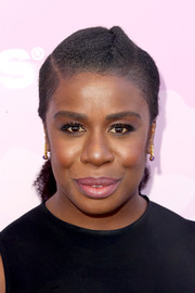 Uzo Aduba styled her hair into a partially braided ponytail when she attended Variety's brunch for awards nominees.