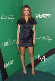 Maria Menounos went for flirty sophistication at the Variety Power of Women event in a super-short navy satin dress with a huge flower-like accent the waist.