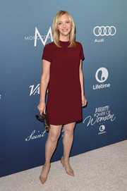 Lisa Kudrow opted for a minimalist look with this maroon shift dress when she attended Variety's Power of Women luncheon.