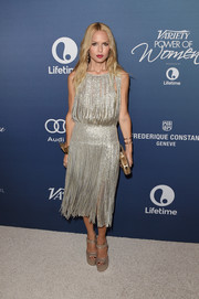 Rachel Zoe added height with a pair of Brian Atwood platform sandals.