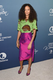 Thandie Newton was bold with her color choices, pairing her green and brown blouse with a magenta silk skirt, also by Bestow Elan.