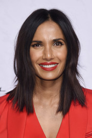 Padma Lakshmi swiped on some red lipstick to match her outfit.
