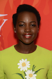Lupita Nyong'o wore her natural curls parted at the side when she attended Variety's Power of Women event.