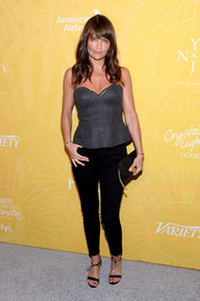 Helena Christensen completed her outfit with a pretty pair of black ankle-tie sandals.