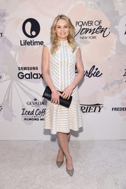 Jennifer Morrison styled her dress with a pair of monochrome print pumps.