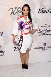 Dascha Polanco chose a pair of brown and white Marskinryyppy booties to team with her dress.