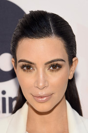 Kim Kardashian opted for an edgy slicked-back hairstyle when she attended the Variety Power of Women event.