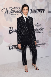 Rachel Weisz teamed her suit with simple black ankle-strap sandals.