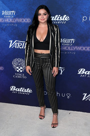 Ariel Winter completed her outfit with a black and gold striped suit by Alice + Olivia.