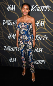 Yara Shahidi styled her outfit with champagne satin sandals by Jimmy Choo.